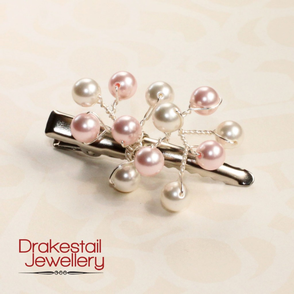 Pink and white Swarovski pearls clustered on an alligator clip, by Drakestail Jewellery.  www.drakestail.com