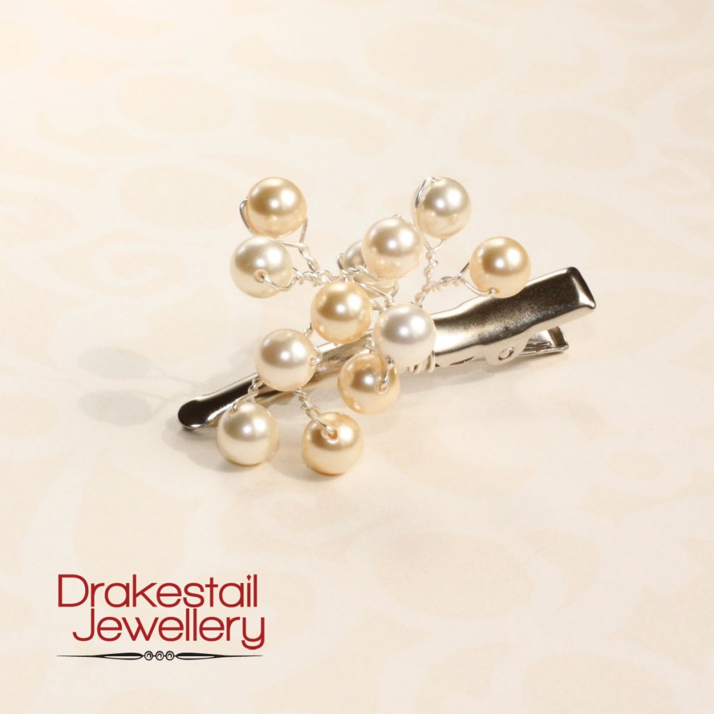 Light gold, white, and mixed Swarovski pearls in a cluster on an alligator clip, by Drakestail Jewellery.  www.drakestail.com